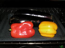 aubergines and bell peppers on the grill
